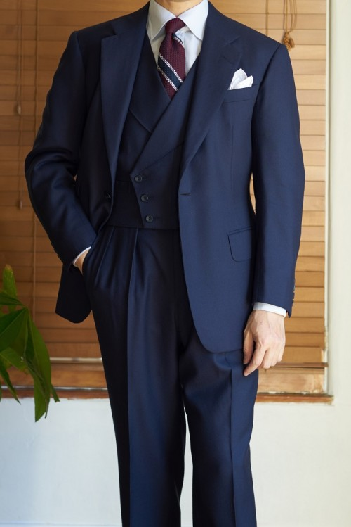Three piece bespoke navy suit, custom tailored by Steed